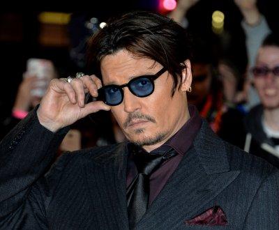 Vu sur le Web : Johnny Depp ému, un 007 qui buzze et Margot Robbie métamorphosée
