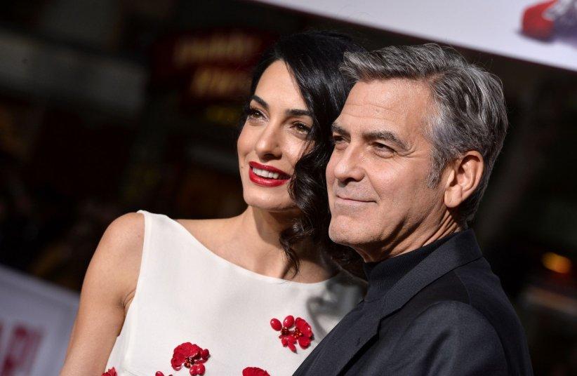 George Clooney et sa femme Amal assistent à la première du film  Ave, César !  en février 2016, à Los Angeles.