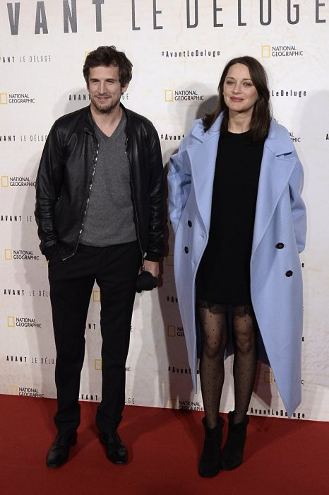 "Marion Cotillard et Guillaume Canet à la première du film documentaire ""Before the Flood"" à Paris, le 17 octobre 2016."