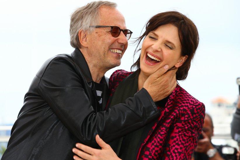 Fabrice Luchini et Juliette Binoche pendant le photocall de Ma Loute, lors du 69ème Festival de Cannes, le 13 mai 2016.