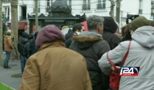 People line up to buy the latest issue of Charlie Hebdo in France