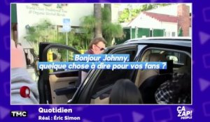 Johnny s'énerve face aux paparazzis