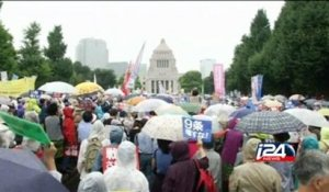 Tens of thousands protest in Japan against security policy