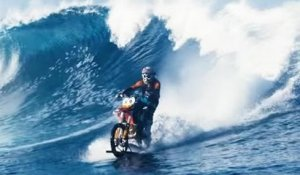 Crazy scene: Biker surfing giant wave with his motorbike
