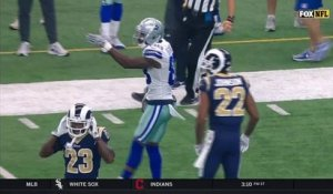 Dez Bryant reaches up to convert on third down