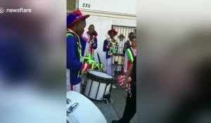 NYPD officer in drum battle with Jamaican marching band