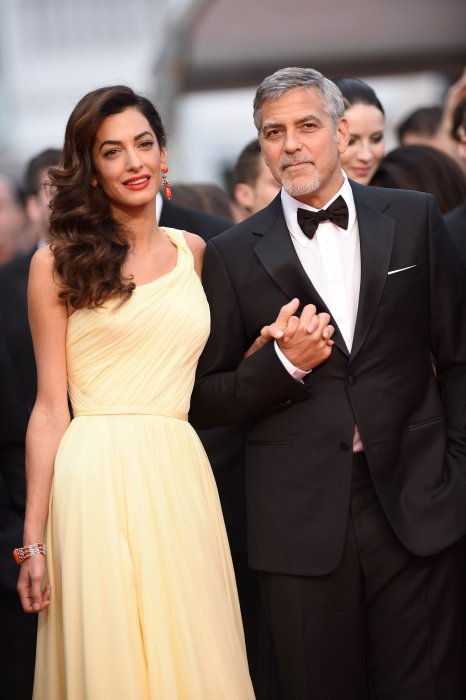 "George Clooney et sa femme Amal Alamuddin à la projection de ""Money Monster"" lors du 69ème Festival de Cannes, le 12 mai 2016."